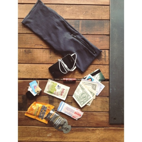 What's in my HipsSister?  The running essentials: iPhone + headphones, ID, Credit Card, Cash,  Sugar Lip Treatment, Blum face wipes, keys, Jelly Belly Sport Beans, AccelGel, Bandaids